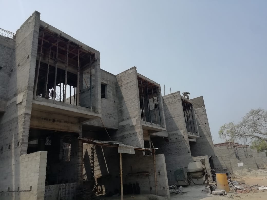 roof slab casting of row house no. 145, 146 and 147 of cluster 23 have been completed as on 30.03.2021